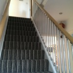 Oak handrail and chrome tube spindles