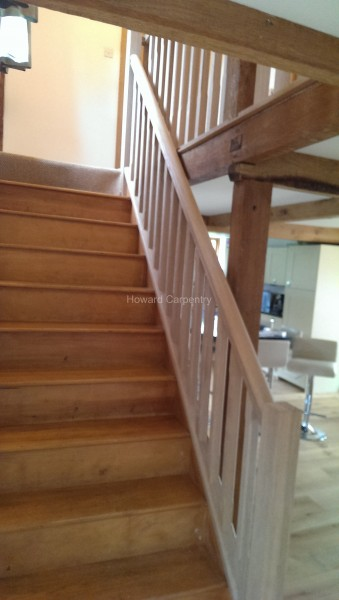 Pine staircase with oak string, base cap and handrail