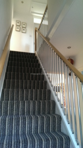 Oak handrail and chrome tube spindles